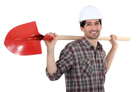 Man holding shovel photo