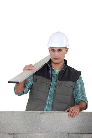 Builder stood by uncompleted wall Stock Photo - 17904230