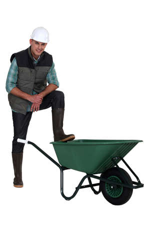 barrow: Construction worker with empty wheelbarrow