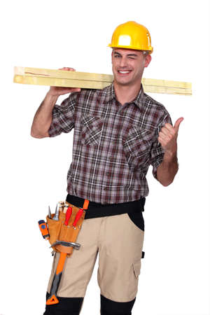 Satisfied building worker on white background photo