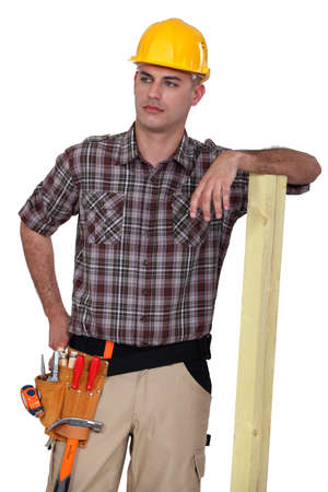 specialty: Worker resting on plank of wood