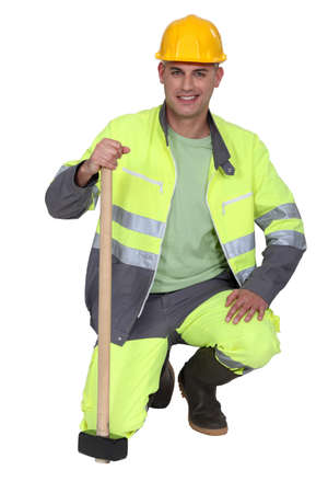 all smiles: portrait of bricklayer all smiles with safety outfit