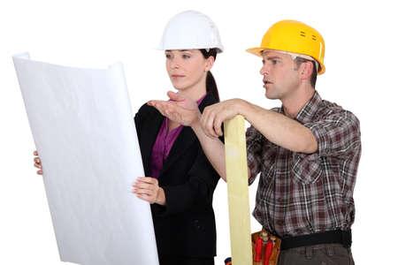 oversight: Architect and foreman having debate