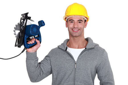 wood cutter: craftsman holding an electric saw
