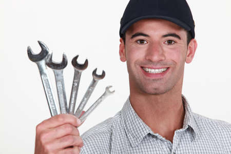 open end wrench: Man holding wrenches Stock Photo