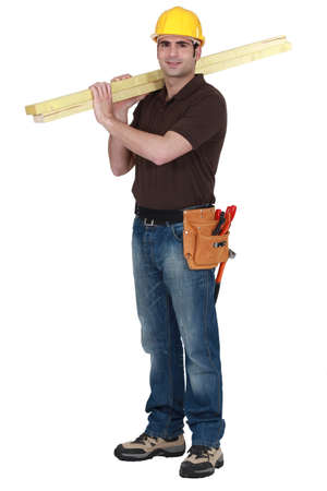 construction workers: Builder carrying timber