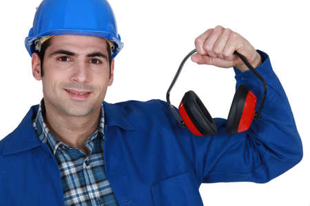 eye protectors: Construction worker with ear defenders