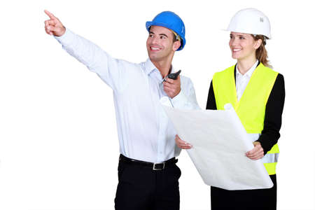 all smiles: female architect all smiles accompanied by foreman Stock Photo