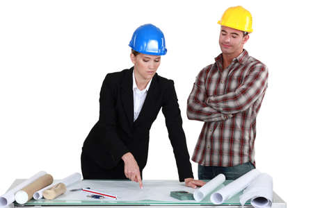 Architect and builder discussing plans Stock Photo