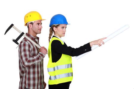 Tradesman following an engineers orders photo