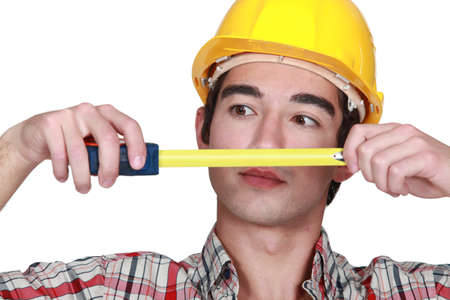 banter: Young craftsman tape measure Stock Photo