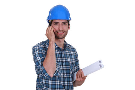 rolled up sleeves: Artisan plans on the phone Stock Photo