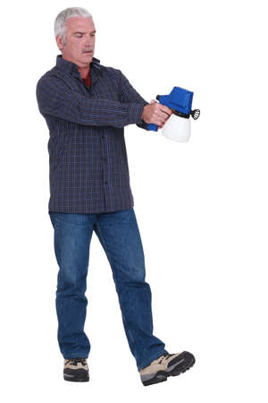 Man holding a spray gun photo