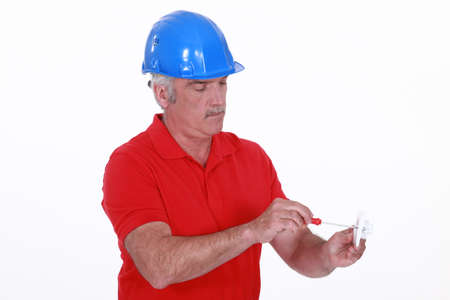 wireman: craftsman holding a screwdriver and an electric socket
