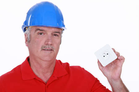 energy work: Builder with a continental power socket