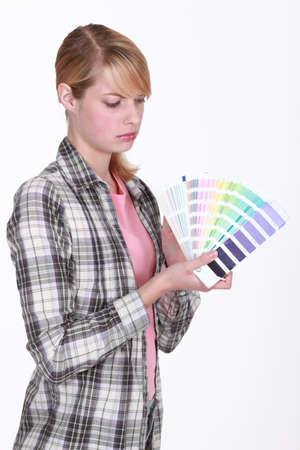 grouch: Woman holding up paint samples