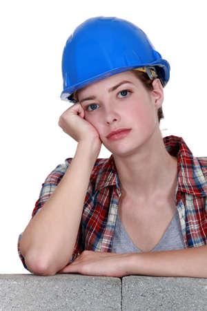 blase: A bored tradeswoman Stock Photo