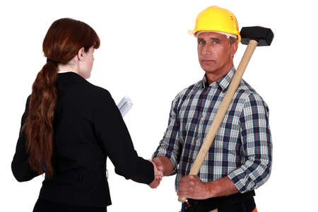 Tradesman shaking the hand of an engineer Stock Photo - 17904189