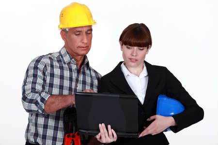 Architect and builder with a laptop photo