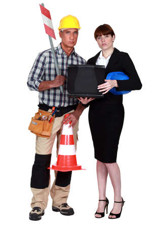 Labourer and engineer working together Stock Photo