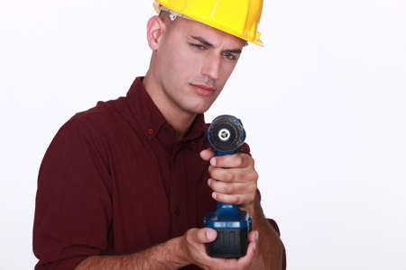 vindictive: Tradesman aiming his power tool