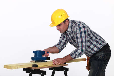 smoothen: Workman using a power tool