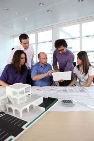 Group of people working in an architects office photo