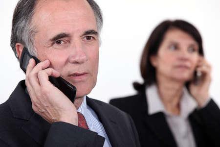 executive affable: Executives on the phone