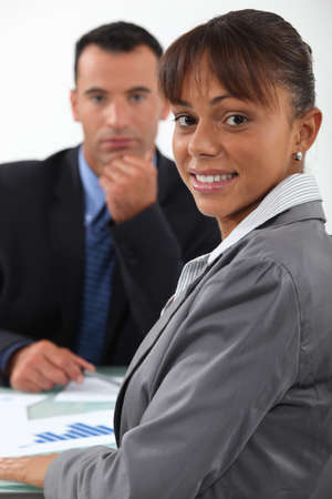 combined effort: businessman and businesswoman having a discussion Stock Photo