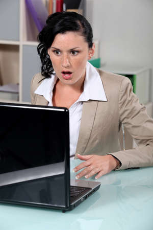 Brunette having technical problems Stock Photo - 17976964