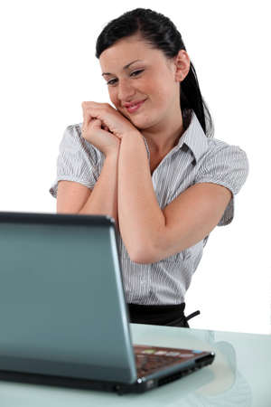 Excited brunette sat at desk Stock Photo - 17976693