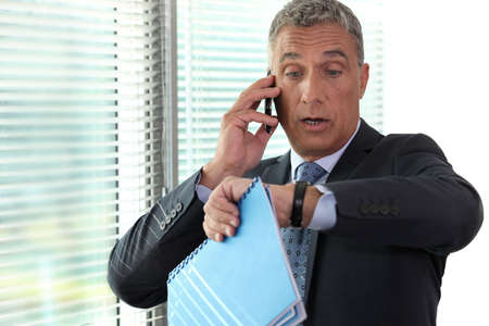 forgetful: Businessman realizing he is late Stock Photo