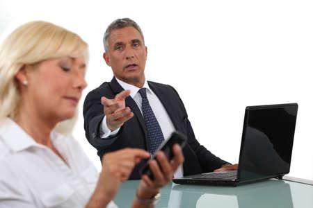 disdain: Businessman criticising his colleague