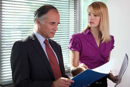 business duo consulting files in office Stock Photo - 17977278