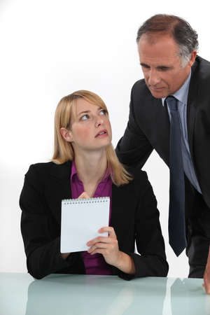 jot: Woman silently communicating with her boss Stock Photo
