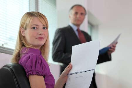 clerical: Secretary processing paperwork