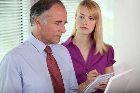 taking notes: Secretary taking notes
