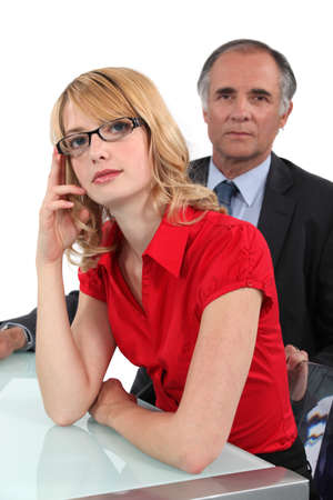 secretary desk: Businessman sat with young intern