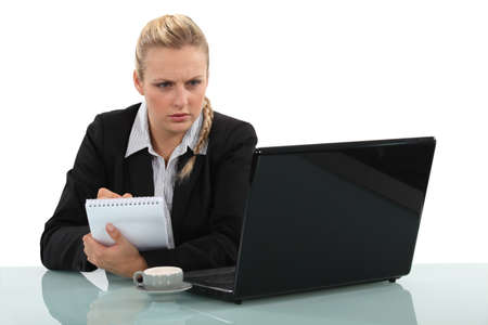 Woman working at a desk photo