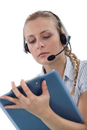 Woman with a headset and clipboard Stock Photo - 17976630