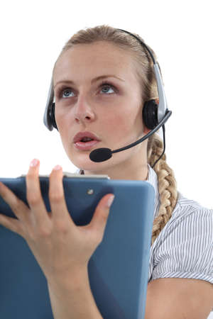 Woman with a headset and clipboard Stock Photo - 17976715