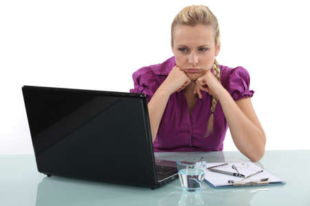 hindrance: Frustrated woman staring at her laptop