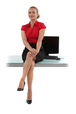 aplomb: Smart woman sitting on her desk