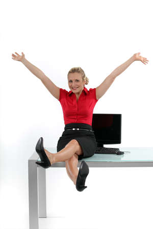 table skirt: Relaxed woman sitting on her desk
