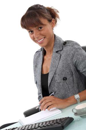 Secretary writing in diary Stock Photo - 17977517
