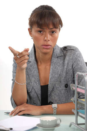 exasperate: irritated businesswoman showing you the way out