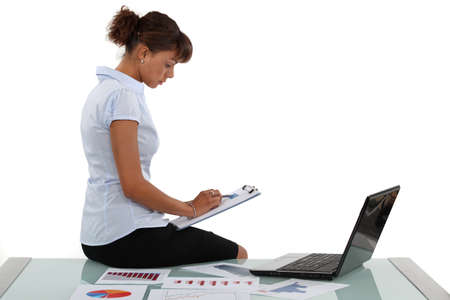 Woman checking financial records Stock Photo - 17976442
