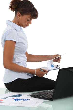 qualitative: Woman reviewing the results of a market research Stock Photo