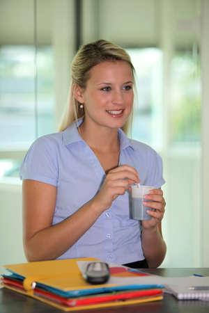 taking a break: A businesswoman taking a coffee break. Stock Photo