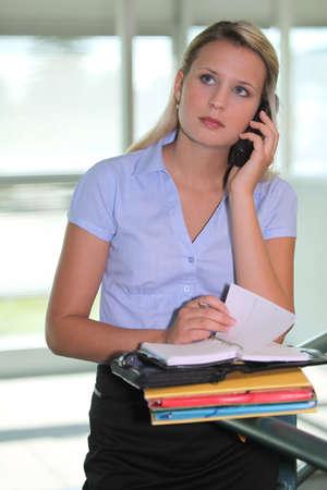 Secretary answering a telephone Stock Photo - 17977069